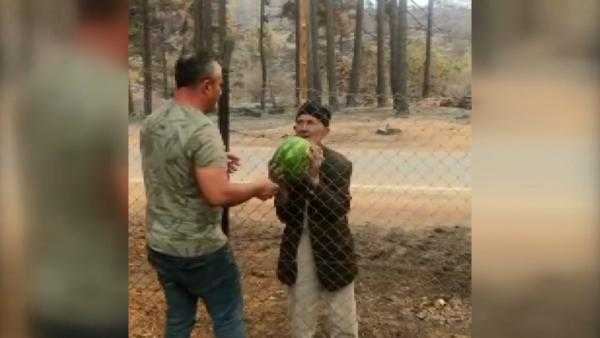 93 years old wildfire victim offered watermelons to the forest workers
